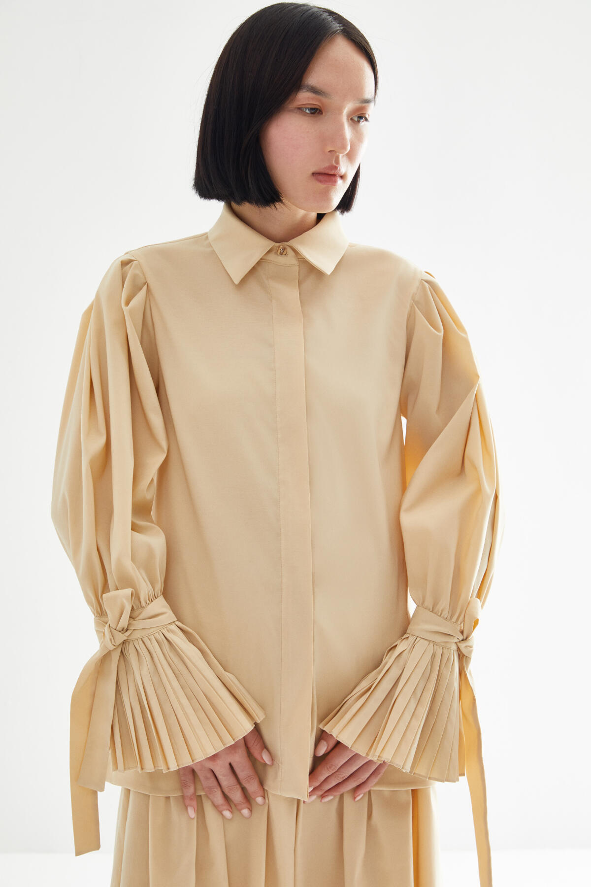 SHIRT WITH PLEATED ARM